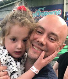 Greg Wilkinson with his daughter Molly, who has Xia-Gibbs Syndrome